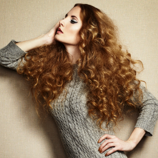 Signature Style hair model with long, curly hair