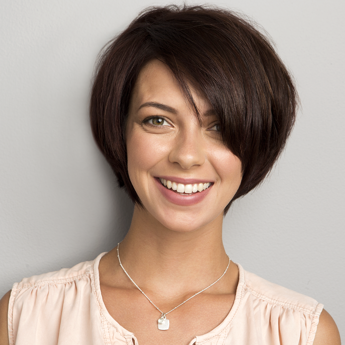 woman's face framing bob haircut